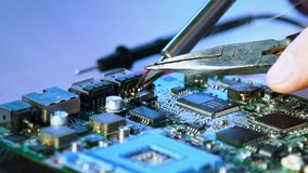 Computer engineer developer soldering motherboard. Computer hardware engineering. technology science concept. developer soldering motherboard stock video footage