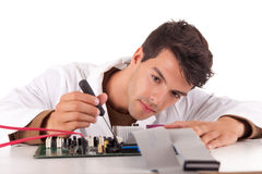 Computer engineer. Happy and successful young computer engineer Royalty Free Stock Photo