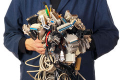 Computer engineer holding many different cables wires connectors Stock Photo