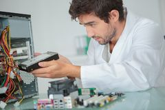 Computer engineer installing hard drive royalty free stock photography