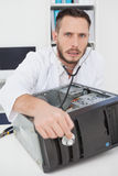 Computer engineer listening to console with stethoscope Stock Photography