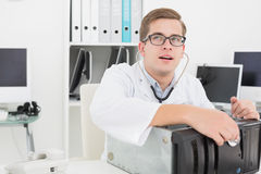 Computer engineer listening to console with stethoscope Stock Images