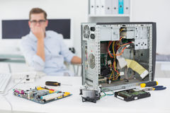 Computer engineer looking at broken console Royalty Free Stock Images