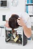 Computer engineer looking at broken device Stock Images