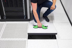 Computer Engineer Pulling Floor Tile Using Suction Cups In Datac Royalty Free Stock Photo