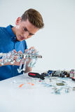 Computer engineer repairing computer motherboard Stock Photography