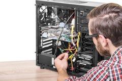 Computer engineer repairs the computer. Computer engineer repairs or mount the computer Stock Photo