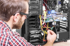 Computer engineer repairs the computer Stock Photography