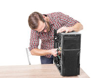 Computer engineer repairs the computer Stock Images