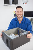 Computer engineer sitting with open computer smiling at camera Stock Image