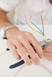Computer engineer working on broken cables Stock Photo
