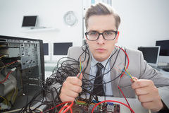 Computer engineer working on broken cables. In his office Stock Photos