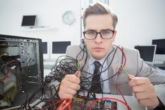 Computer engineer working on broken cables Stock Photos
