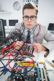 Computer engineer working on broken cables. In his office Royalty Free Stock Images