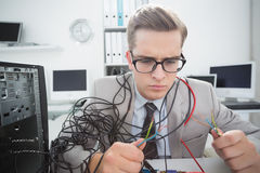 Computer engineer working on broken cables. In his office Royalty Free Stock Photography