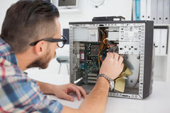 Computer engineer working on broken console. In his office Royalty Free Stock Photo