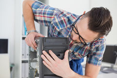 Computer engineer working on broken console Stock Photography