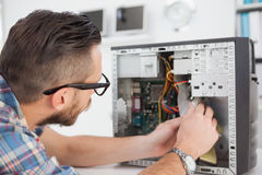 Computer engineer working on broken console Royalty Free Stock Photos