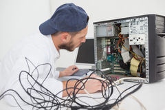 Computer engineer working on broken console Royalty Free Stock Photography