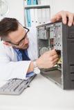 Computer engineer working on broken console Stock Photo