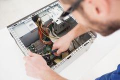 Computer engineer working on broken cpu Stock Images