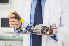 Computer engineer working on broken cpu Stock Photos