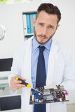 Computer engineer working on broken cpu Royalty Free Stock Images