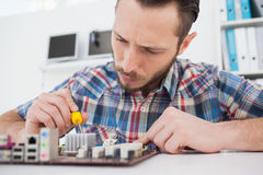 Computer engineer working on cpu with screwdriver Stock Photography