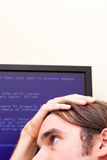 Computer error concept. Unhappy man looking at computer error message. Blue Screen of Death royalty free stock photo