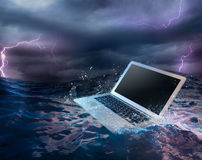 Computer failure concept with laptop on water Stock Photo