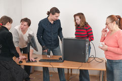 The computer and family. All family was gathered to look at the new computer royalty free stock image