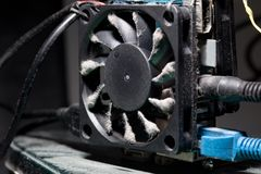 Computer fan with blades covered with a layer of dust stock photo