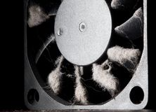 computer fan with blades covered with a layer of dust royalty free stock photo