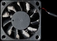 Computer fan with blades covered with a layer of dust stock images