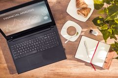 Computer with financial analysis program. Stock Images
