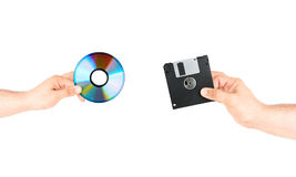 Computer Floppy Disk Versus New CD DVD Disc. Concept Compassion On Isolated Background With Space For Text stock photos