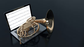 Computer with French horn Royalty Free Stock Photography
