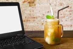 Computer and fruit tea Stock Image