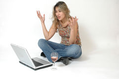 Computer Frustration. Beautiful latino woman frustrated with her lap top computer. Woman upset by an email or chat session. Woman upset at something on line Stock Image