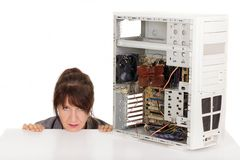Computer frustration. Frustrated woman and broken computer Royalty Free Stock Photos
