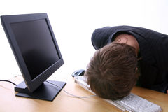 Computer frustration. Young businessman student or office worker with head on keyboard slepping or give up. hammer head on keys in frustration. blank computer Royalty Free Stock Photos
