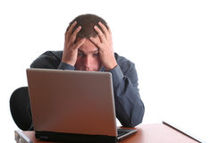 Computer frustration, stress. Frustratoed male at computer, hands in hair isolated Royalty Free Stock Image