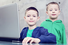 Computer fun. Two brothers having fun with laptop - kids and family stock images