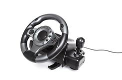 Computer gaming steering wheel. Game played on the computer Royalty Free Stock Photos