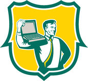 Computer Geek Technician Laptop Shield Retro. Illustration of a computer geek technician man carrying computer laptop on shoulder looking to the side set inside Stock Photography