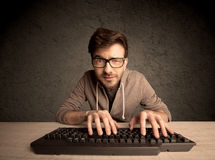 Computer geek typing on keyboard Stock Image
