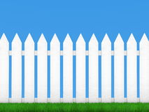 White fence and blue sky Stock Photos