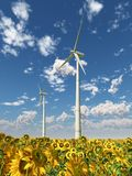 Wind turbines in a field of sunflowers. Computer generated 3D illustration with wind turbines in a field of sunflowers Stock Photo