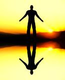 Computer generated man reflection at sunset. Stock Photo