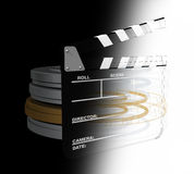 Computer generated movies. Movie slate and reel cans computer generated Royalty Free Stock Photos